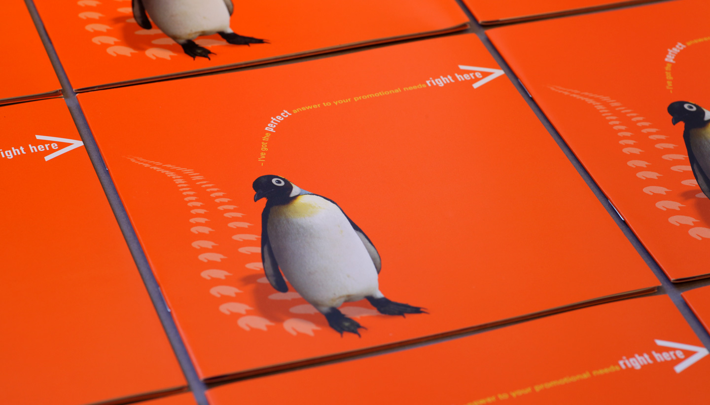 Penguin Books sales brochure cover which is brighton orange with a cutout photo of a penguin