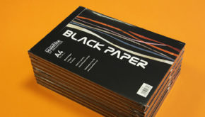 Stack of Seawhite pads containing black paper with cover designed by Toop Studio