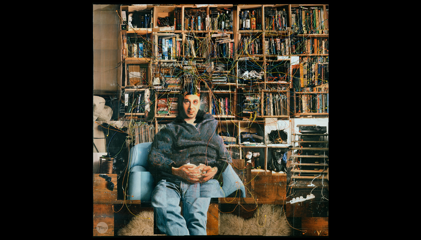 An artwork called Mind Map by Shadric Toop which has a figure sat in front of a wall of shelves containing all his possessions which are all wired up to his head