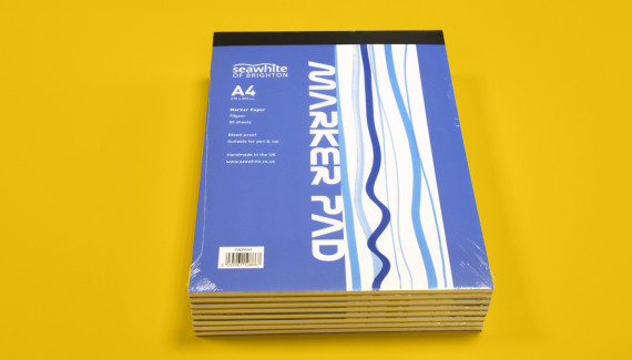 Stack of Seawhite sketchbooks marker pads