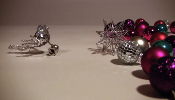 Little bird talking to Christmas baubles - still from stop frame animation