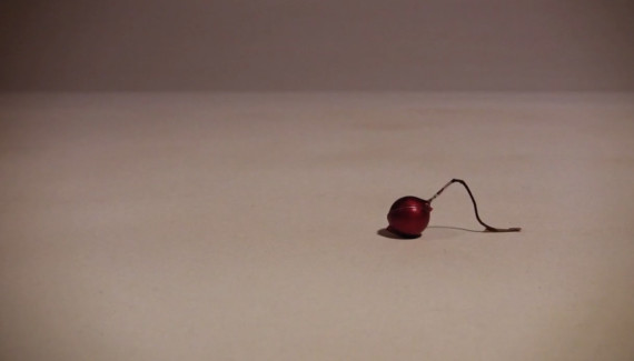 Small Christmas decoration crawling along - still from stop frame animation