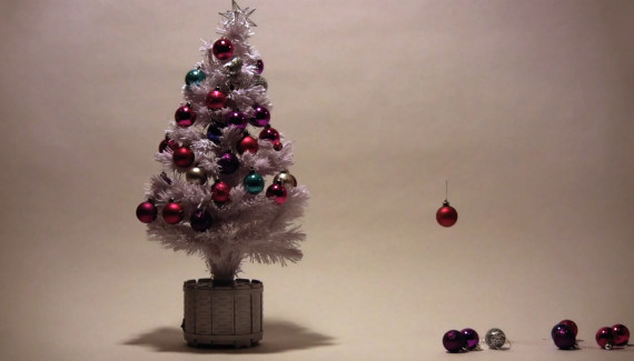 Christmas tree decorations flying up onto tree - still from stop frame animation by Toop Studio