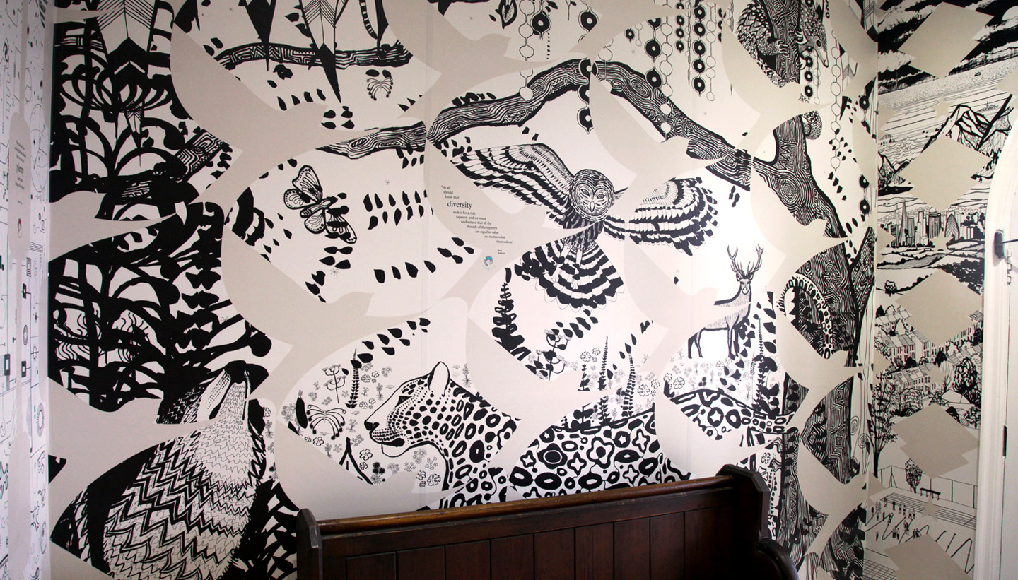 Detail of the Maya Angelou wall graphic at Varndean School featuring black and white illustrations of owl tree and leopard