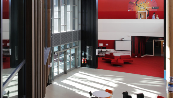 Wellington Academy performing arts entrance wall showing a red stage curtain using Trompe-l'œil effect