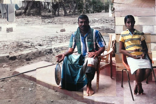 Thotamuna fisherman and his niece detail sitting outside a wooden shack 4 months after the boxing day tsunami Sri Lanka