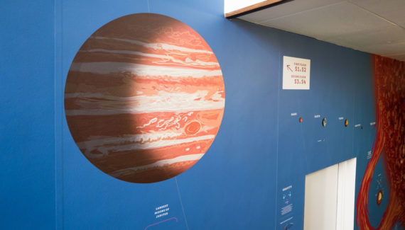 Toop Studio wall graphic showing jupiter