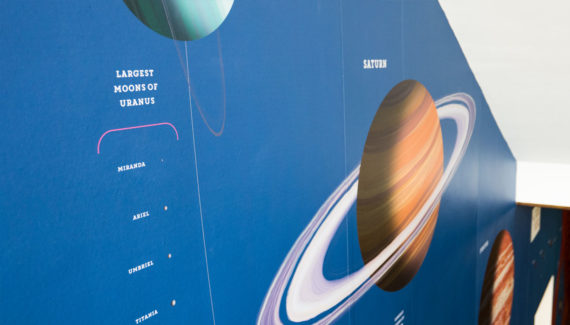 School wall graphic mural design showing Saturn
