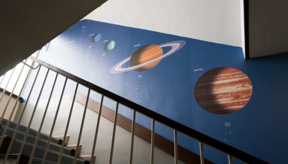 school wall graphics for science stairwells - showing the solar system on a stairwell wall - work by Toop