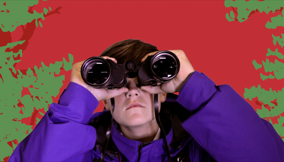 School film still showing student looking through binoculars