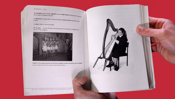 School video still showing open book with black and white picture of student playing harp
