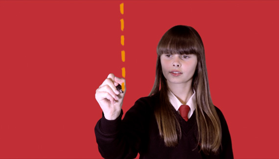 School film still showing female student drawing a vertical dotted line - work by Toop Studio