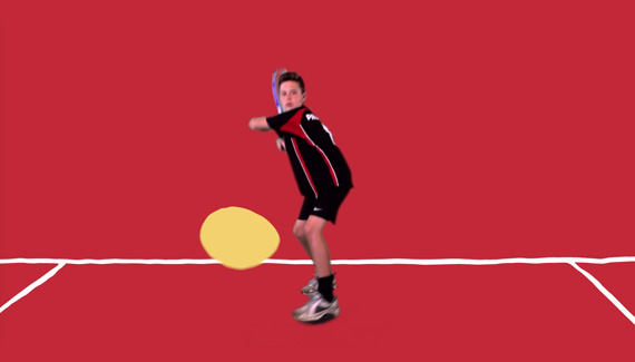 School video still showing male student playing tennis