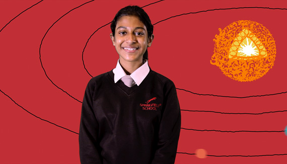 School video still showing female student smiling in front of animated diagram of the solar system