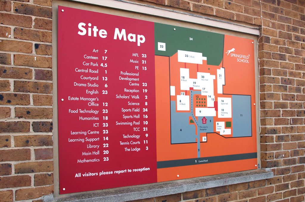 A sign on a brick wall showing a site map of school buildings - illustrating 'S is for Signage' in A to Z design for schools blog