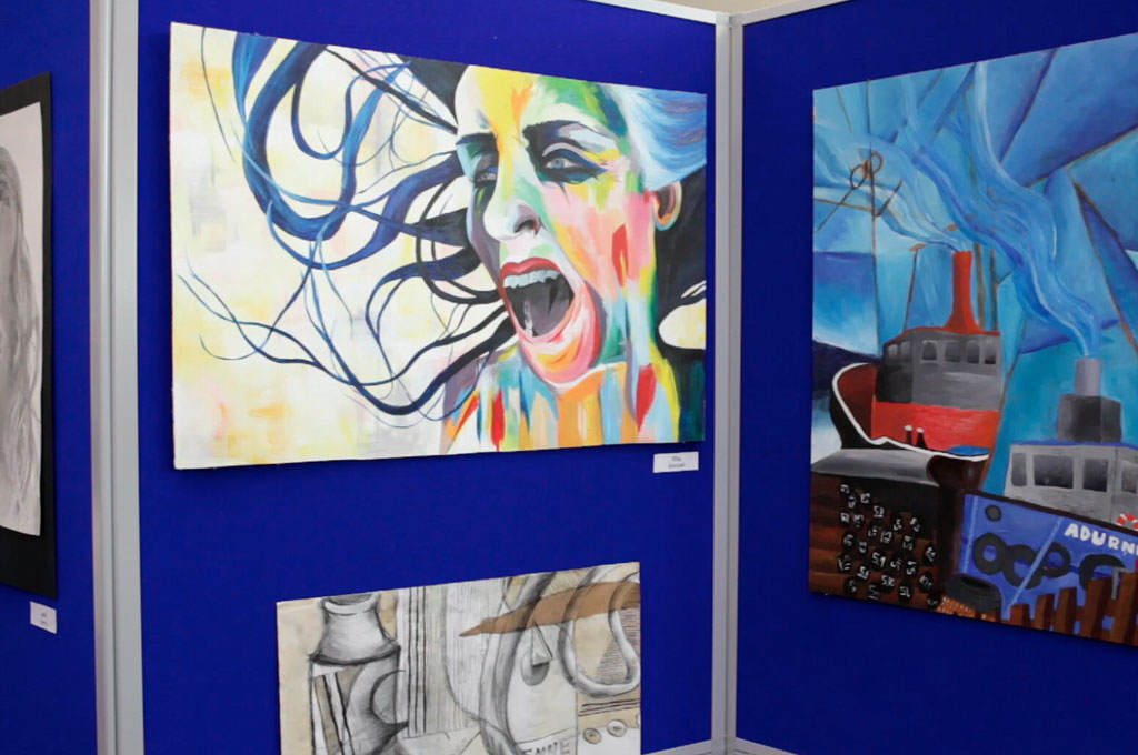Some paintings by high school students on display - illustrating Y is for Young Creative Talent in A to Z design for schools blog