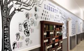 British Values wall graphic - showing Education Tree of words with a bookcase set into the wall - illustrated wall design