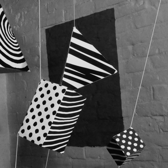 Patterns in Motion - Black and White patterned cuboids hanging in space - set for an ident video - Shadric Toop